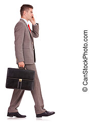 business man with briefcase on the phone