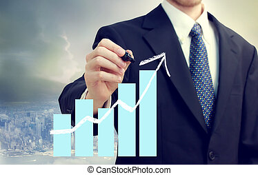 Business Man with Chart Showing Growth - Business man with a...