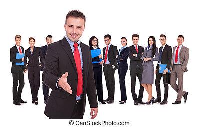 business man with handshake gesture infron of team