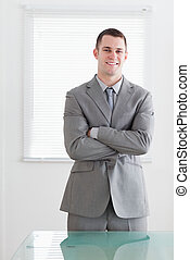 Business man with his arms folded and smiling