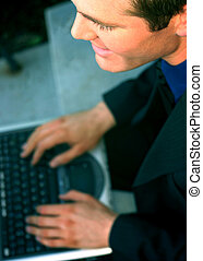 Business man with laptop 25 - Business man in black suit and...