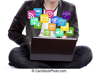 Business man with laptop and colorful application icons