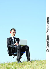 Business man with laptop