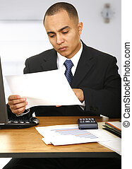 Business Man With Serious Expression Looking At Paper