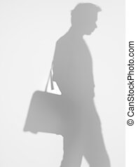 business man with shoulder bag, silhouette