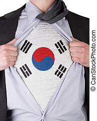 Business man rips open his shirt to show his South Korean flag t-shirt