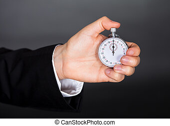 Business man holding stop watch in his hand