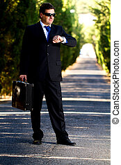 business man with suitcase on a road
