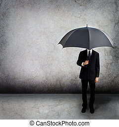 Business man with umbrella