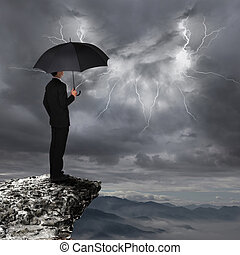 Business Man with umbrella look rainstorm cloud - Business...