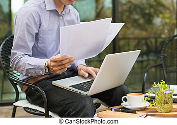 business man working in outdoor using laptop