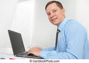 business man working on computer in office