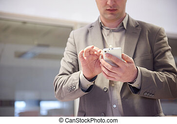 business man working on phone at office