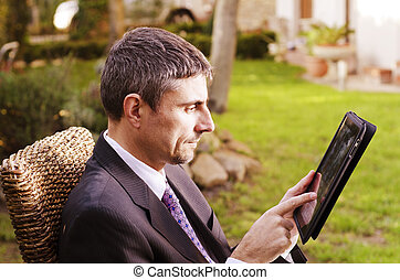 Business Man Working Outdoor with his Tablet