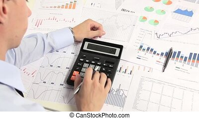 Business man working with calculator in the office