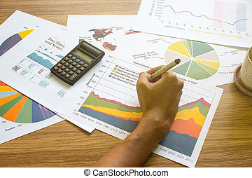 business man working with graphs and charts