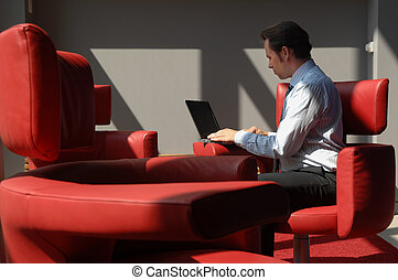 Business Man Working With Laptop In A Meeting Room