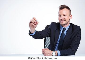 business man writes on imaginary screen