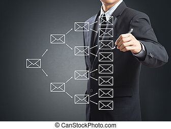 writing e-mail sign - Business man writing e-mail sign on...