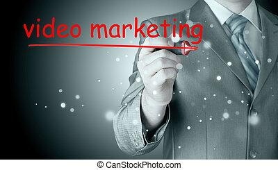 business man writing Video Marketing