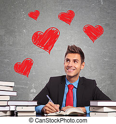 business man writting a love letter at his office desk