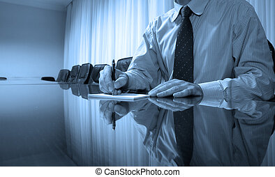 Business manager writing on blank paper in board room, business concept, BLUE TONE