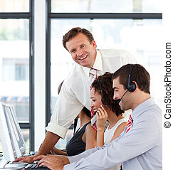 Business manager smiling his  team is working