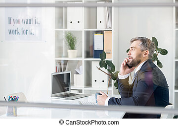 Business manager talking to client on phone