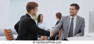 Business meeting at the table with handshake - Two...