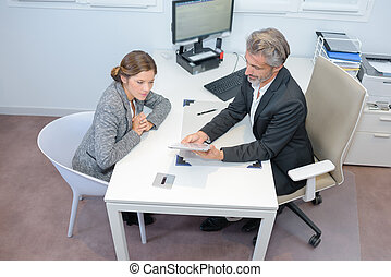 business meeting between man and woman in office