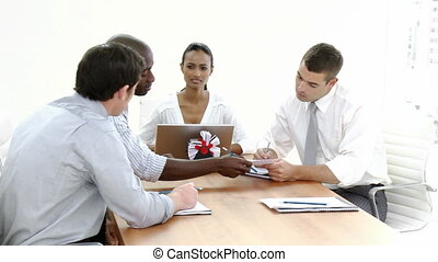 Business meeting - Dolly Shot of a business meeting in...