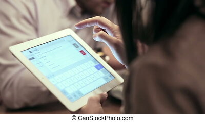 Business meeting in cafe. woman using the tablet