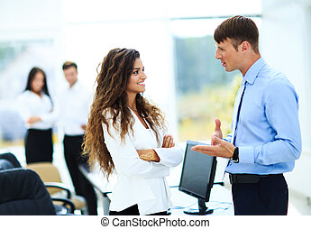 Business - meeting in office, two managers are discussing a document