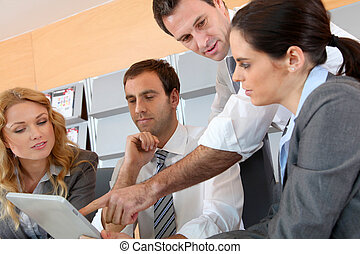 Business meeting in office with electronic tablet