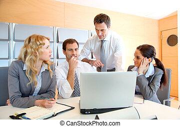 Business meeting in office with laptop computer