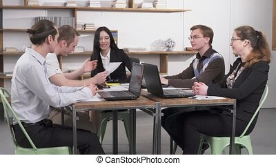 Business meeting in the office - Boss woman conducting a...