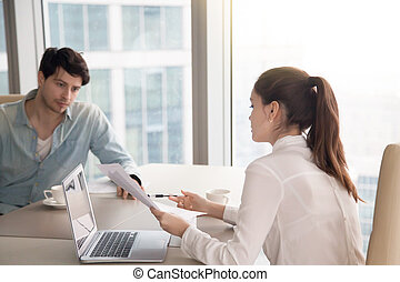 Business meeting, man and woman working on project at office