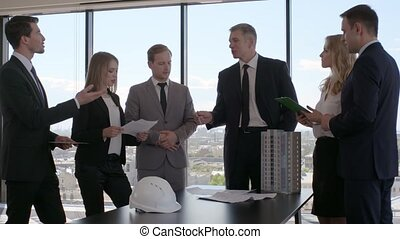 Business meeting of architects and investors