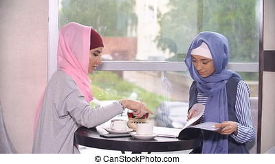 Business meeting of two Muslim women. Business women in hijabs
