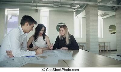 Business meeting of women man sitting inside office