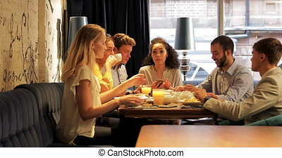 Business Meeting Over Breakfast - Group of coworkers are...