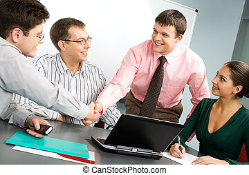 Business meeting - Portrait of confident people shaking...