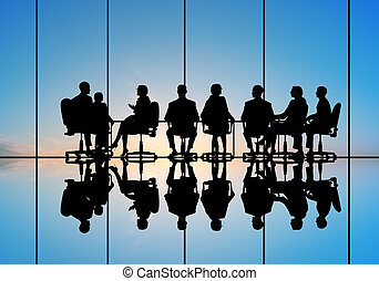 Business meeting - Silhouettes of group of business people ...