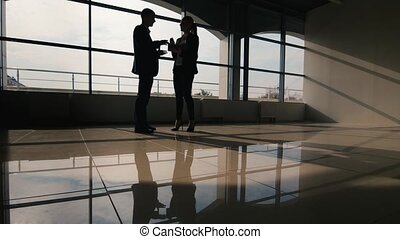 Business meeting, silhouettes of men and women