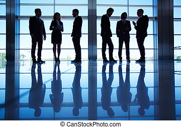 Business meeting - Silhouettes of several office workers...