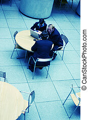 small group of business people conversing at table