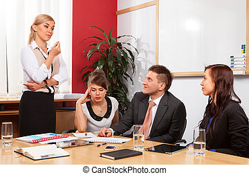 Business meeting - Young businesswoman presenting to...