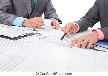 Business people in elegant suits sitting at desk handshake