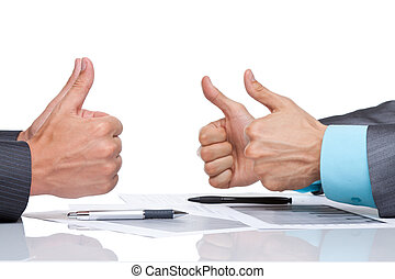 Business men hands at the desk over white background