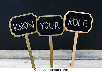 Business message KNOW YOUR ROLE written with chalk on wooden...